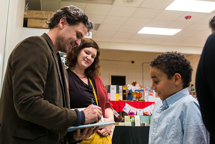 Dave Eggers and Amanda Uhle of 826michigan with a student at the Boggs School in Detroit