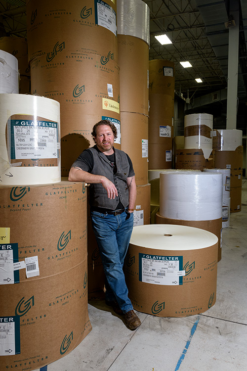 Kevin Spall with the backstock of paper at the Thomson-Shore plant