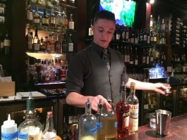 New head bartender Ian Youngs behind the bar at Vinology.