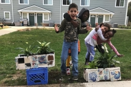 Community Action Network students work on living wall mosaics.