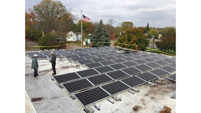 Solar panel installation in progress atop Ypsi's fire station.