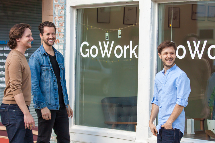 GoWork cofounders Clayton Smith, Kyle Thibaut, and Andrew Sereno stand outside their business.