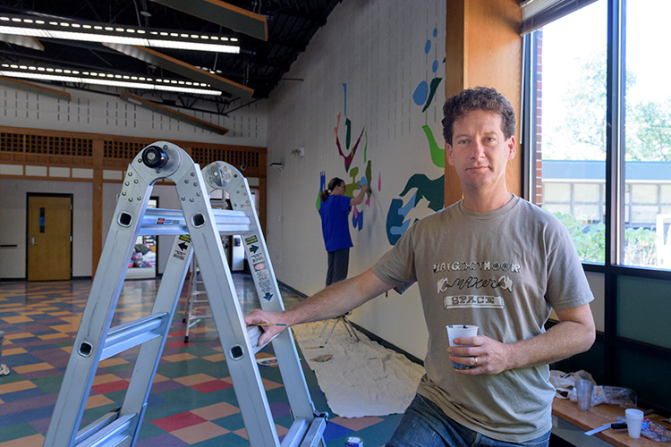 Nick Tobier painting murals at Bach Elementary School in Ann Arbor