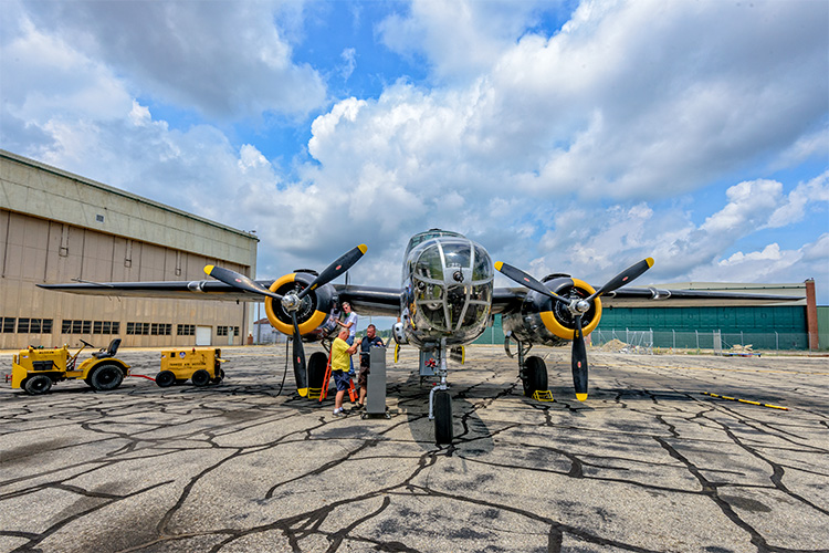 Engine maintenance being performed on the B-25 at the Yankee Air Museum