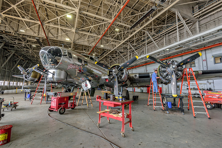 Engine maintenance being performed on the B-17 at the Yankee Air Museum