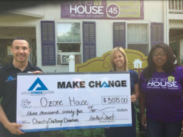 AFS founder Mike Stack presents Ozone House staff with the proceeds from AFS' charity challenge.