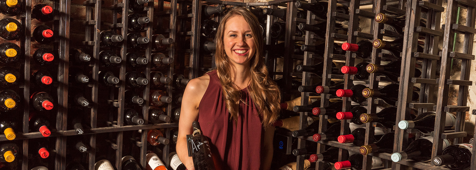 Kelsey Wonsavage in the Aventura Wine Cellar <span class=&apos;image-credits&apos;>Doug Coombe</span>