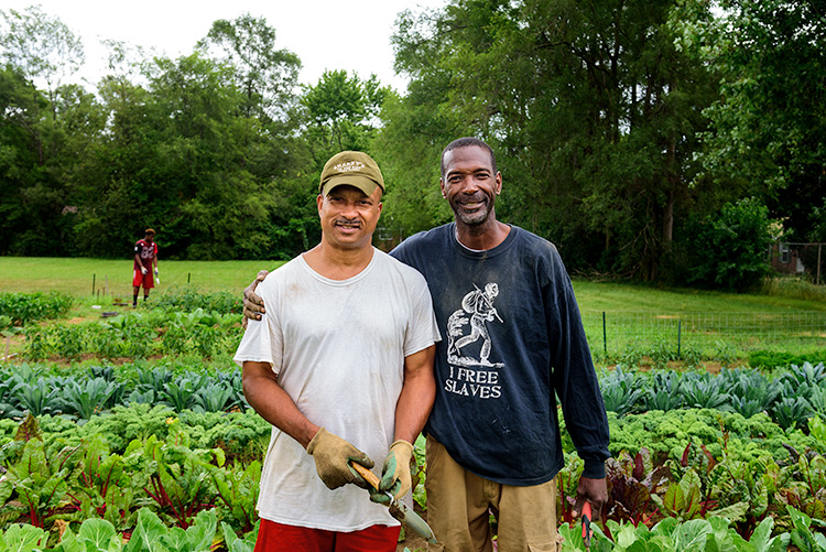 Emanuel Tyus and Melvin Parson at We The People Growers Association gardens