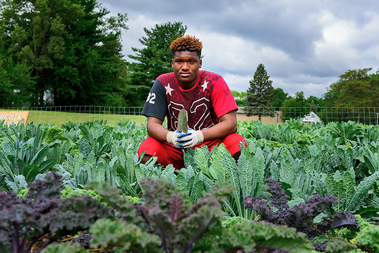 Jamari Jefferson at We The People Growers Association gardens