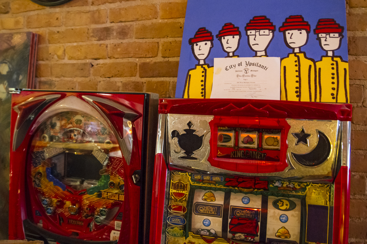 Video games and a Jason Gibner painting of Devo at Ziggy's.