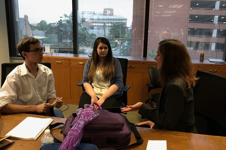 Interns Brandon Lazovic and Nina Drumsta talk with mentor-in-residence Kim Brown.