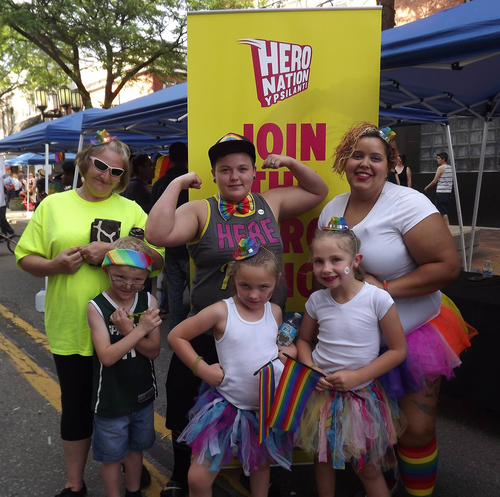 People visit the Hero Nation booth at Ypsi Pride.