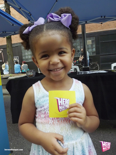 A young visitor to Hero Nation's booth at Ypsi Pride.