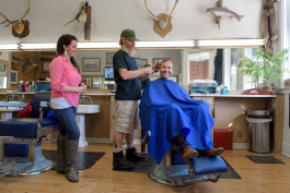 Bill Stolberg gives Riley Hollenbaugh a trim at Bill's Barber Shop.