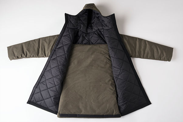 The Empowerment Plan's EMPWR coat, which is self-heated, waterproof, and doubles as a sleeping bag or carrying bag.
