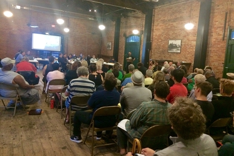 Defend Affordable Ypsi organizer Nathanael Romero speaks at Tuesday night's meeting.