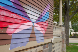 Wings painted on the side of Educate Youth clubhouse.