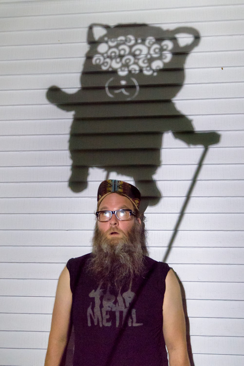 Patrick Elkins with one of his shadow puppets