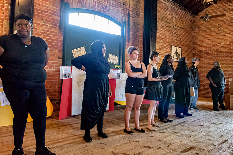 A performance of Voices From Ozone at the Ypsilanti Freighthouse