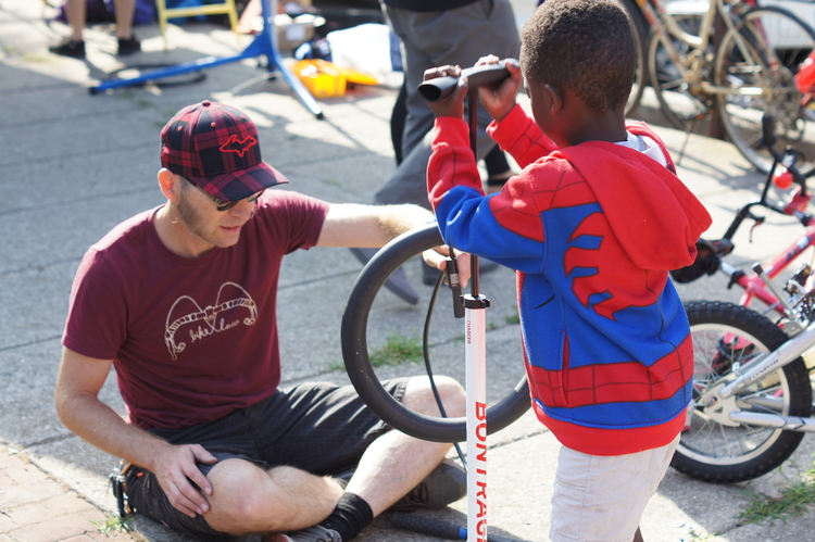 Volunteers and cyclists work together at the Ypsi Bike Co-Op.