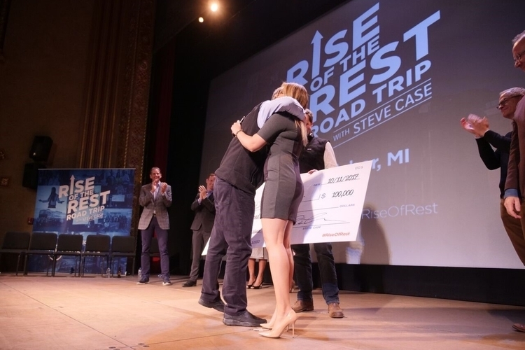 Rise of the Rest founder Steve Case hugs Shelly Sahi after she wins the competition.