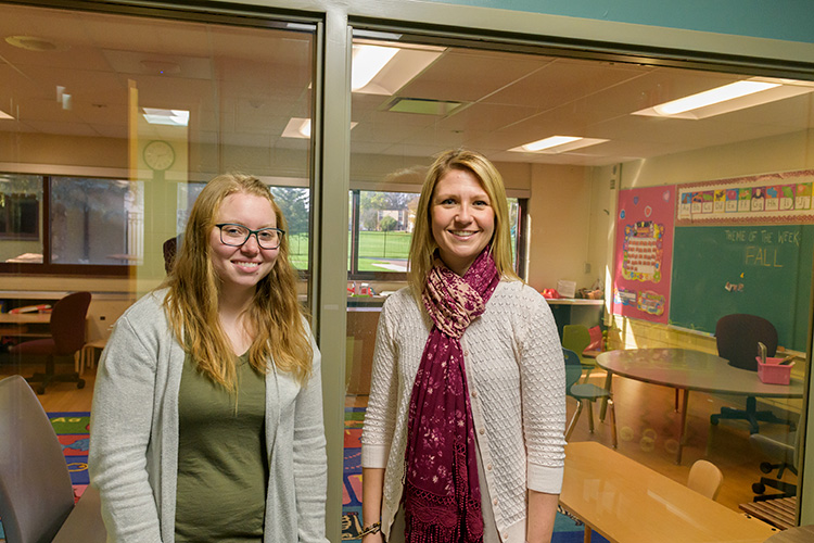 Ashley Rich and Allison Greening in an observation room at the ACC, where parents can watch their children in a classroom through a one-way mirror.