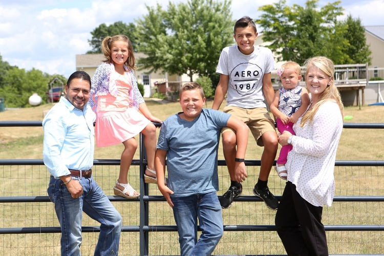 Victor Gamez, Mi Padrino CEO and founder Kim Gamez, and their family.