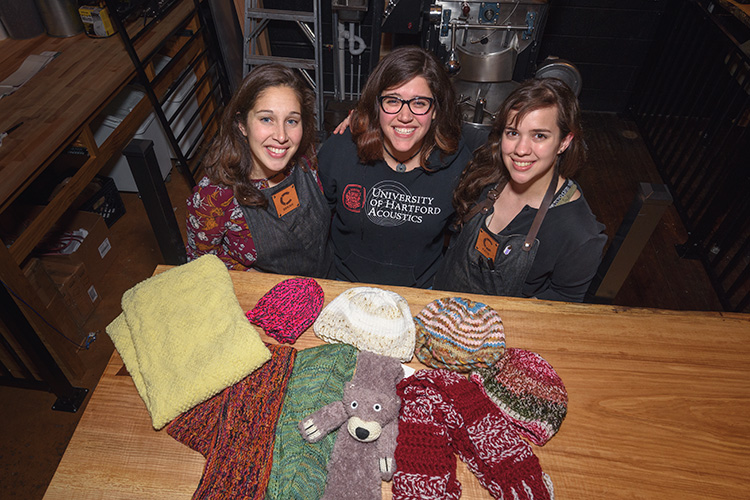 Cultivate knitting group members Bekah Wallace, Hannah Williamson and Katie Morris