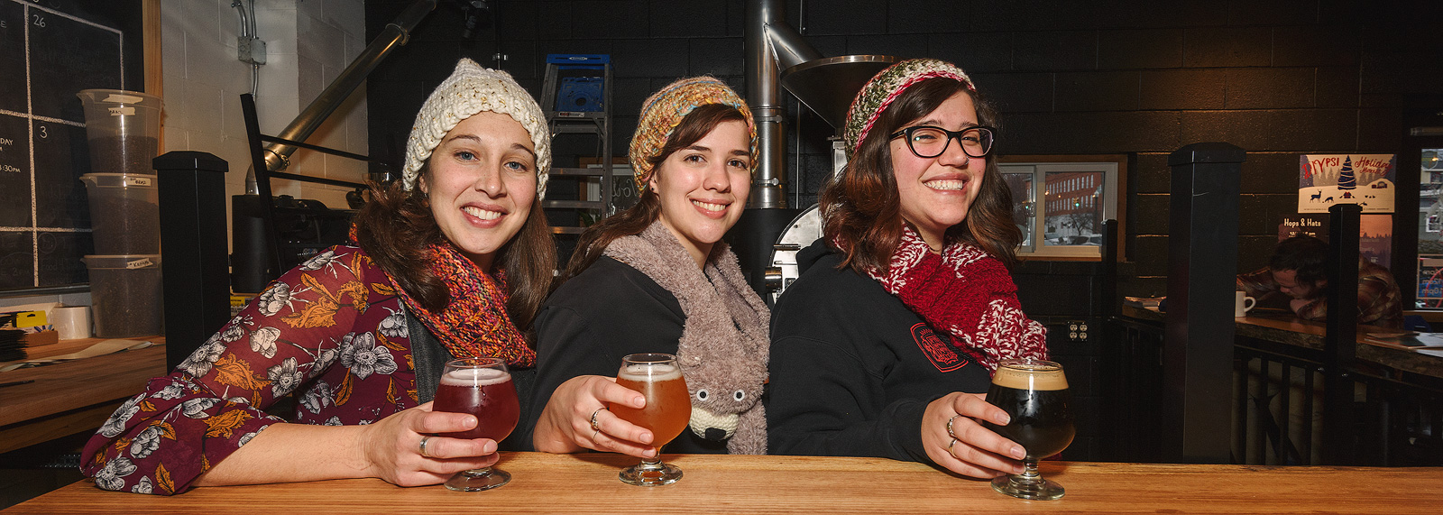 Cultivate knitting group members Bekah Wallace, Katie Morris and Hannah Williamson