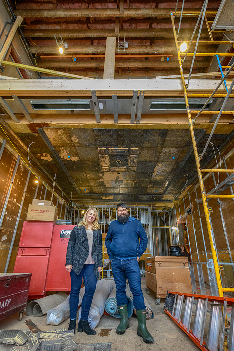 Alison Todak and Joe Malcoun stand in the future lobby at Cahoots