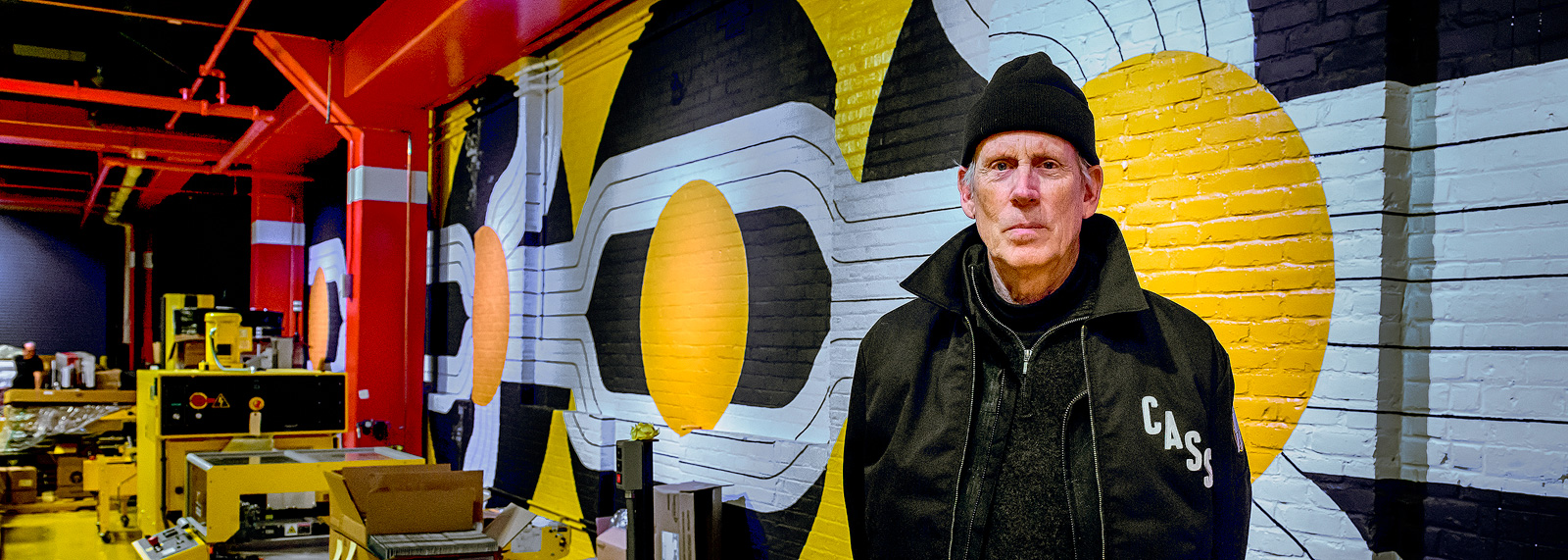 Robert Sestok in front of his mural at Third Man Pressing in the Cass Corridor <span class='image-credits'>Doug Coombe</span>