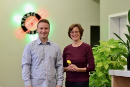 Atomic Object managing partner John Fisher with Koester Performance Research founder Heidi Koester. Koester holds a switch typically used in a switch scanning system.