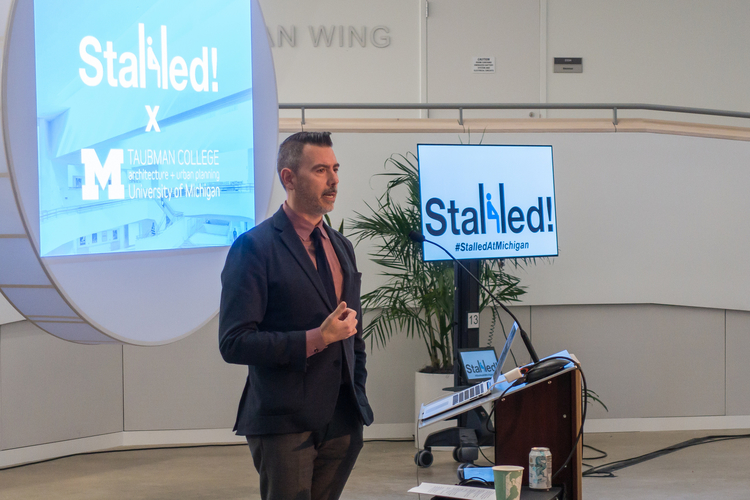 Jonathan Massey introduces Joel Sanders at the Stalled! conference.