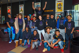 Jermaine Dickerson of Hero Nation with YCHS students at a Black Panther screening at Rave Cinemas