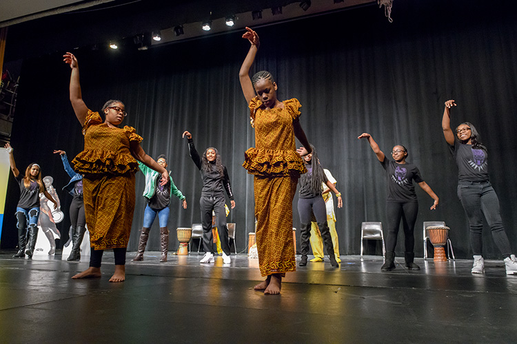 A performance at Ypsilanti High School before the class field trip to Black Panther