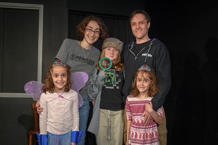 Tori and Jason Tomalia with their kids at Pointless Brewery & Theatre