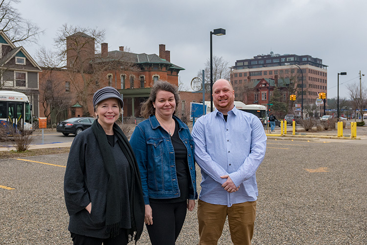 Kit McCullough, Jessica Letaw and Jarod Malestein of YIMBY at the Y Lot in downtown Ann Arbor