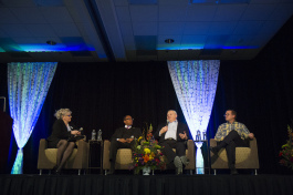 Michelle Mueller, Eugene Grant, Craig Hupy, and James R. Sayer participate in a panel discussion.