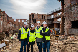 Rob Eisman, Liz Marek, Greg Lobdell and Jon Carlson at the Thompson Block redevelopment on April 2, 2018