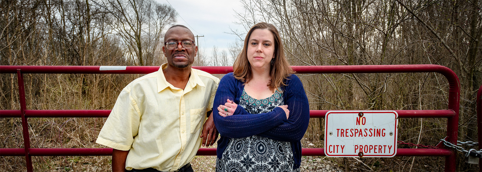 Michael Simmons and Erin Snyder outside the former landfill adjoining the Bell Kramer neighborhood <span class='image-credits'>Doug Coombe</span>