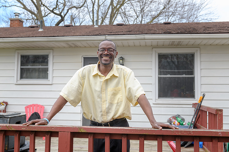 Michael Simmons outside his home on Bell Street