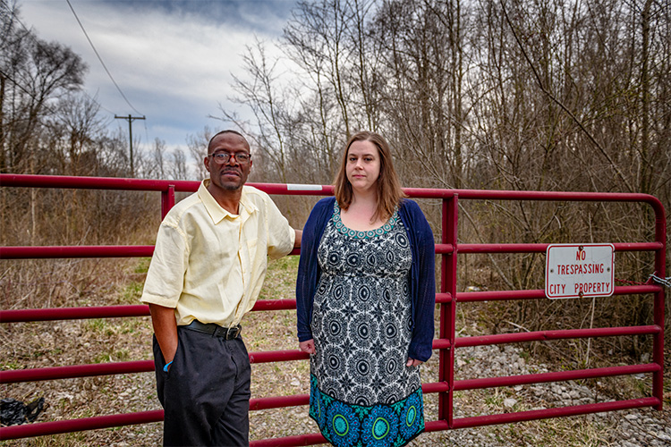 Michael Simmons and Erin Snyder outside the former landfill adjoining the Bell Kramer neighborhood