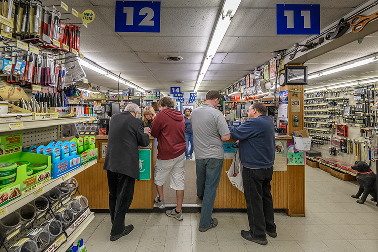 Customers at the counter of Stadium Hardware