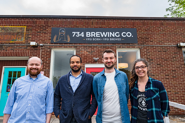 Patrick Echlin, Brian Jones-Chance, Alex Merz and Mariah Gavin outside of 734 Brewing Company in Depot Town Ypsilanti