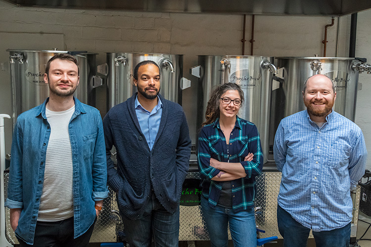 Alex Merz, Brtian Jones-Chance, Mariah Gavin and Patrick Echlin inside of 734 Brewing Company