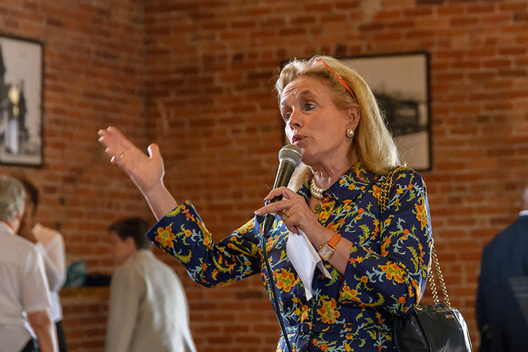 Congresswoman Debbie Dingell speaks to Bridging 23 participants at the Ypsilanti Freighthouse