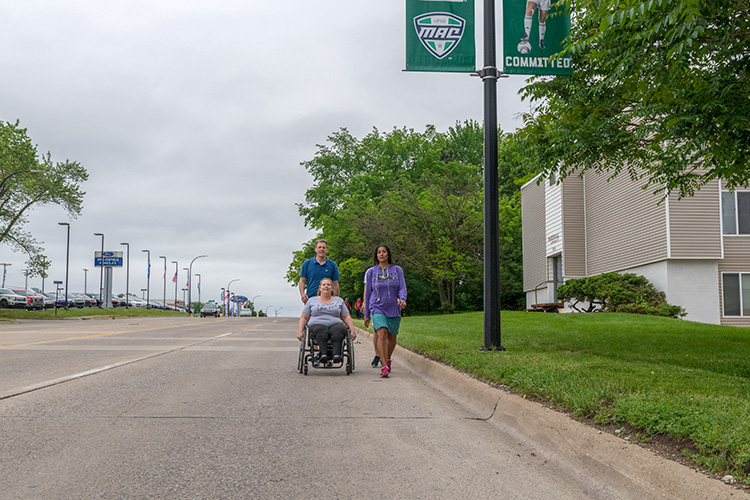 Katie Jones takes her wheelchair onto Washtenaw Avenue along one of the stretches without sidewalks