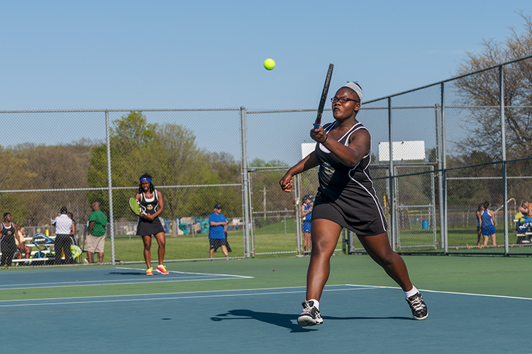 The YCHS Girls Tennis Team playing Lincoln High School