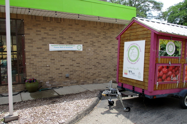 Growing Hope will continue to use its mobile food stand and will turn the former KeyBank drive-thru building at 16 S. Washington St. into a Welcome Center for the Tuesday farmers market.