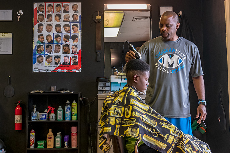 Village Project success coach Ryan Griffin at Griff's Unlimited Cutz